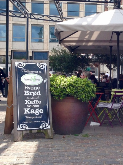 """Sign advertising """"Hygge Broed"""" which means """"Hygge Bread"""" in front of """"Grannys House"""" - a cafe/bakery at Torvehallerne in Copenhagen"""